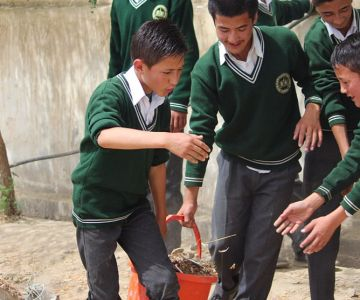 A group of kids cleaning the surroundings